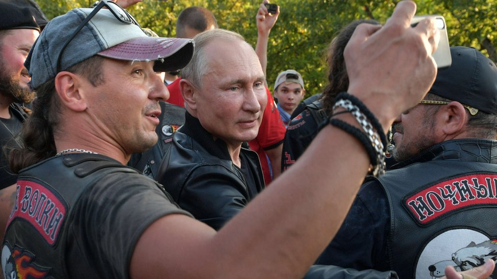 "Russia's President Vladimir Putin greets participants of a bike show organized by motorcycling club ""Night Wolves"" in Sevastopol, Crimea on 10 August 2019"