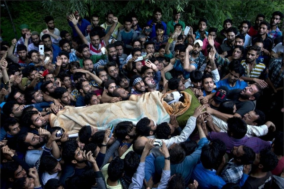 "In this July 9, 2016 file photo, Kashmiri villagers carry the body of Burhan Wani, chief of operations of Indian Kashmir""s largest rebel group Hizbul Mujahideen, during his funeral procession in Tral, some 38 Kilometers (24 miles) south of Srinagar, Indian controlled Kashmir."