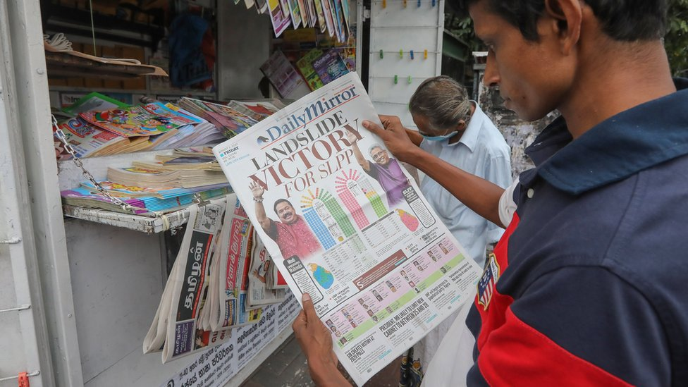 A person looks at a newspaper with parliamentary elections coverage, in Colombo, Sri Lanka, 07 August 2020.