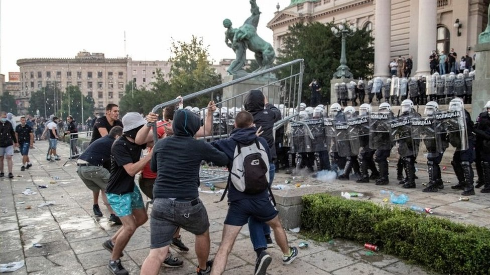Protesters clash with riot police in front of the parliament building in Belgrade, Serbia. Photo: 9 July 2020
