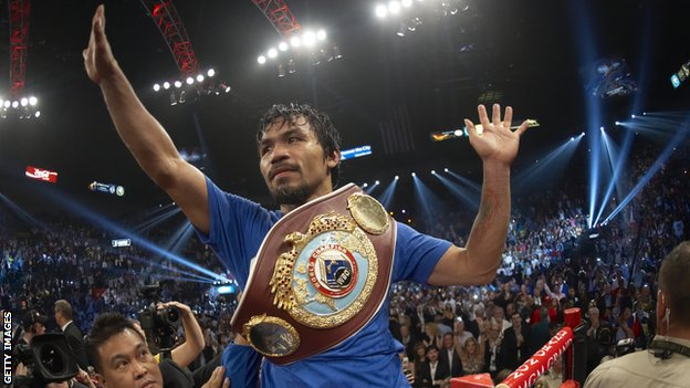 Manny Pacquiao celebrating with the WBO Welterweight belt after beating Shane Mosley in 2011