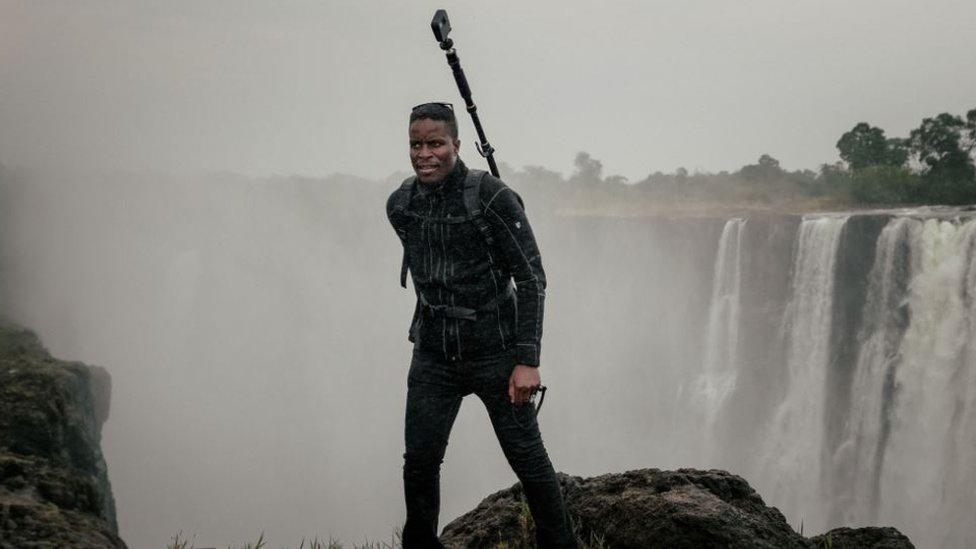 Tawanda staning near the Victoria Falls