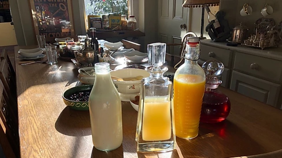 Juice and milk on a shared breakfast table at Ellesmere House B&B