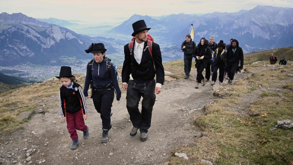 """Locals, hikers and environmental campaigners attended the """"funeral march"""" for the Pizol glacier"""