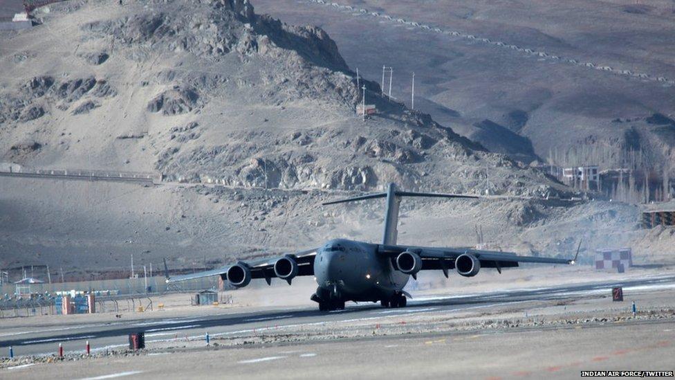 Plane at mountain airstrip Daulat Beg Oldi