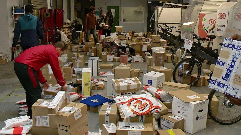 man sorting through parcels
