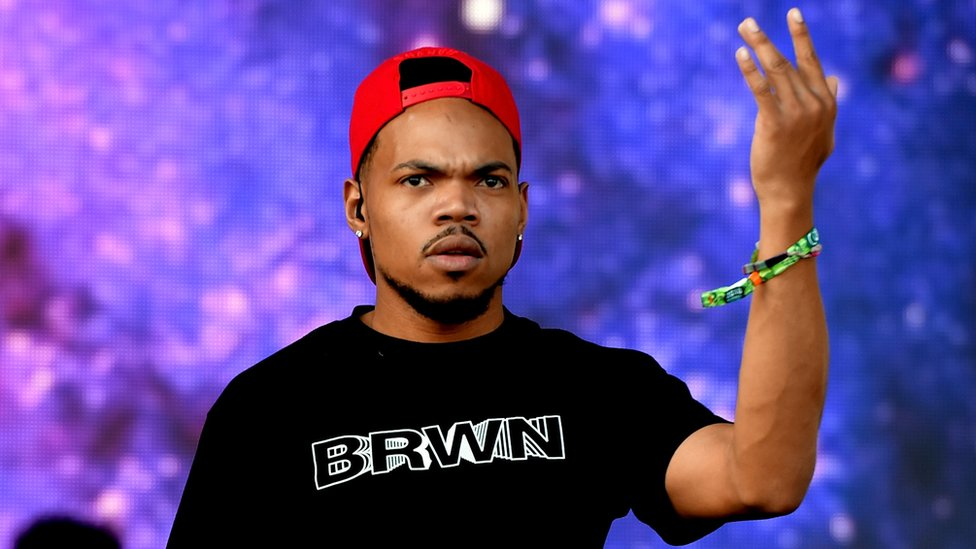 Chance the Rapper, who says he has purchased the Chicago news website Chicagoist, seen here performing, 4 July 2018