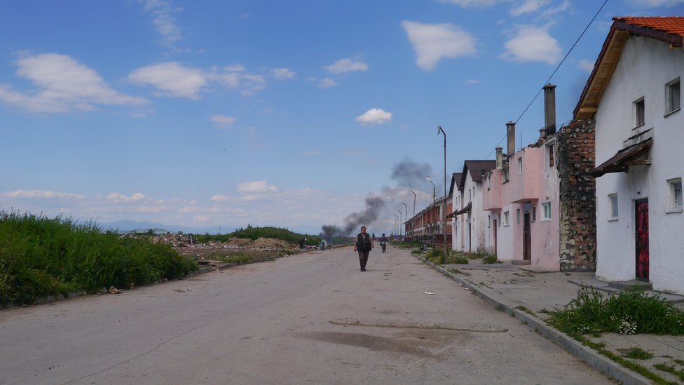Street in Pazardjik with houses in precarious conditions and abandoned land