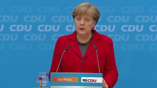 Angela Merkel at podium during press conference