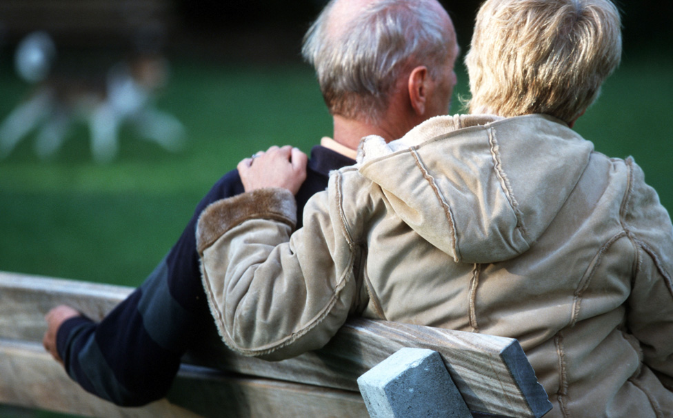 Older couple on a park bench - posed by models