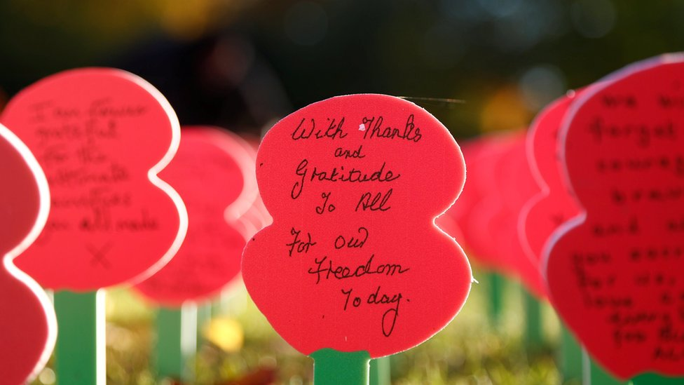 Poppies with messages are seen next to the Menin Gate Memorial in Ypres at the Menin Gate Memorial in Ypres