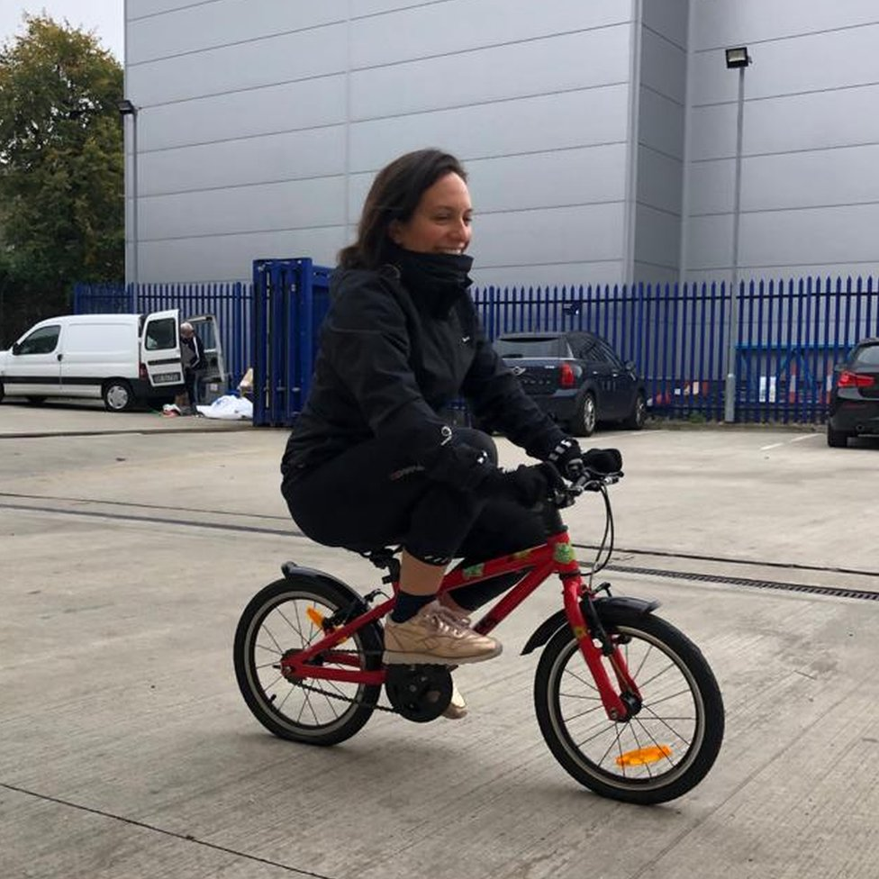 Laura cycling to work.