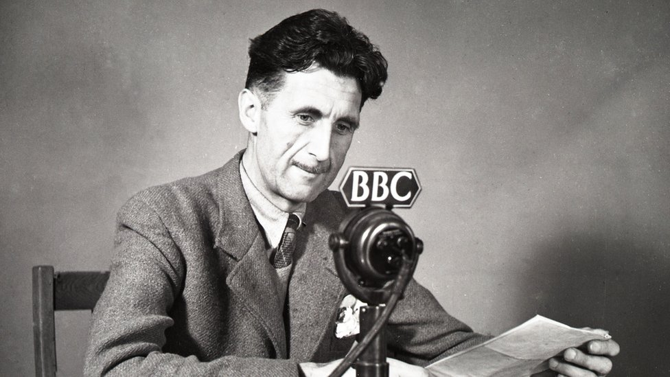 George Orwell in front of a BBC microphone