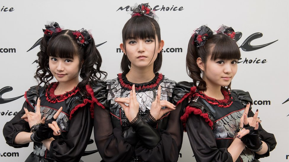 (L-R) Yuimetal, Su-metal, and Moametal of the band Babymetal Visit Music Choice on April 4, 2016 in New York City