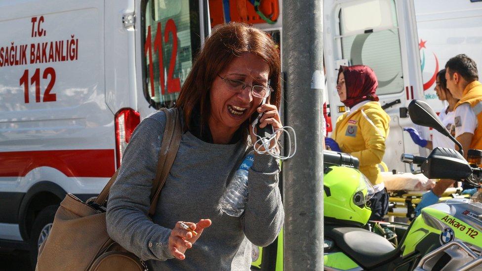 A survivor talking on a phone after the explosions in Ankara, Turkey - Saturday 10 October 2015