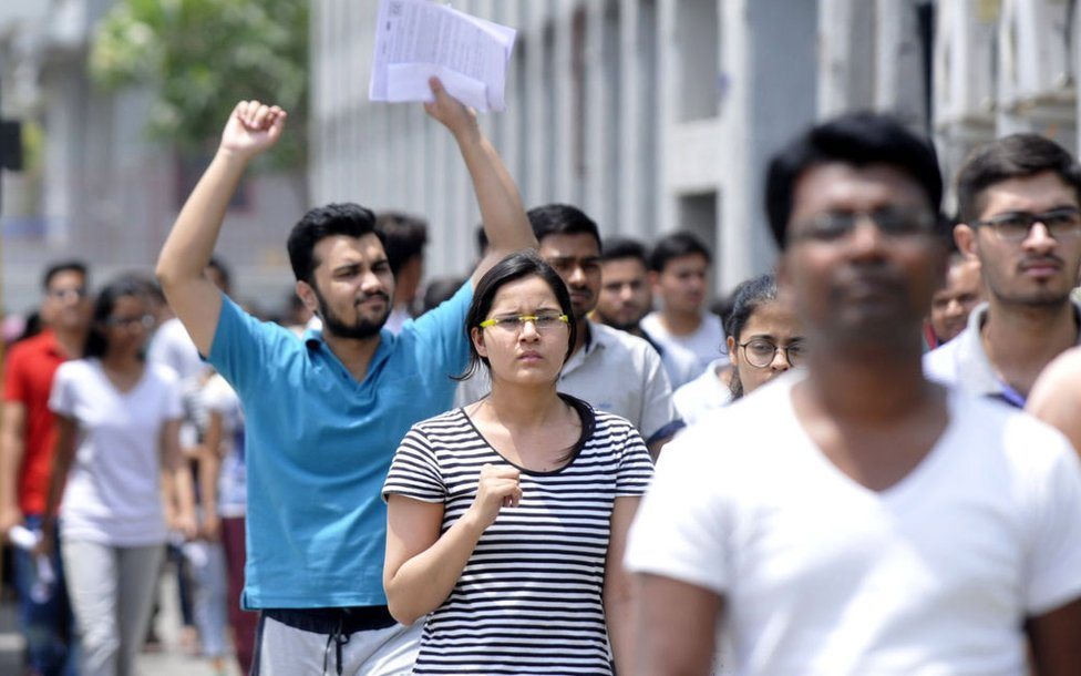 Students come out after appearing for NEET Exam, on May 6, 2018 in Noida, India.