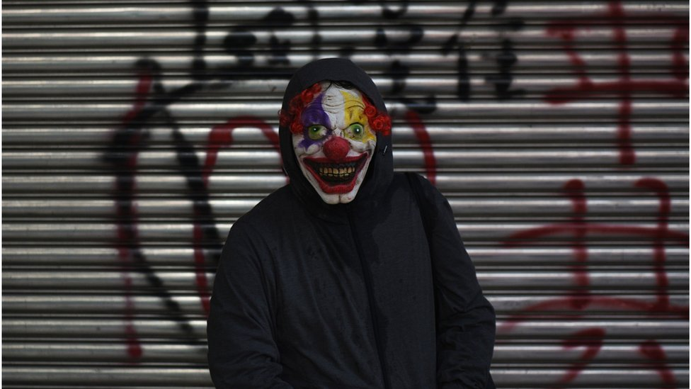 A protester wearing a scary clown mask poses during a rally in Tsuen Wan district in Hong Kong on October 1, 2019,
