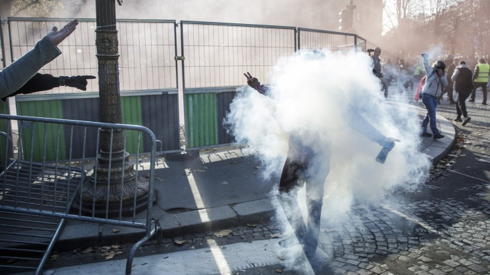 Tear gas is used to disperse protesters in Paris