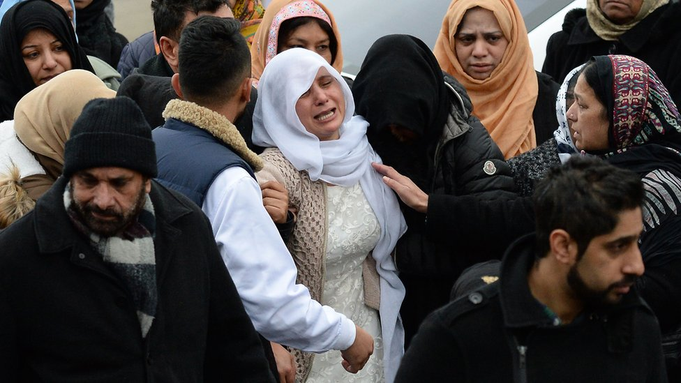 The mother of Mohammed Yassar Yaqub, is comforted at Masjid Bilal Huddersfield