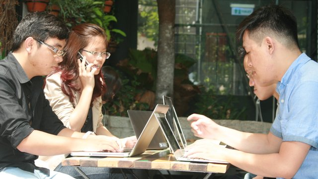 Thuy Truong working outside with colleagues