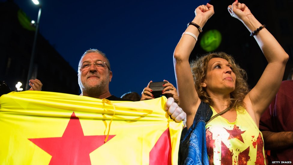People react to the results of exit polls on September 27, 2015 in Barcelona