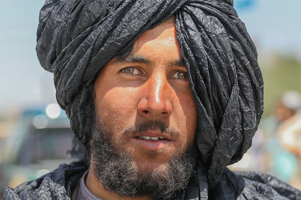 A Taliban fighter poses for a photograph in Kabul, Afghanistan, 16 August 2021