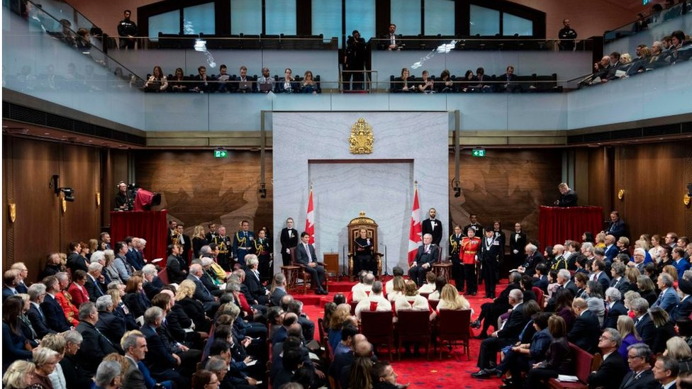 Governor General Julie Payette delivers the Speech from the Throne as Prime Minister Justin Trudeau looks on in December 2019