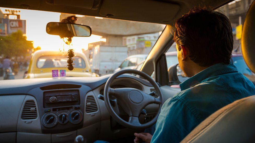 An Indian driver on road during rush hour