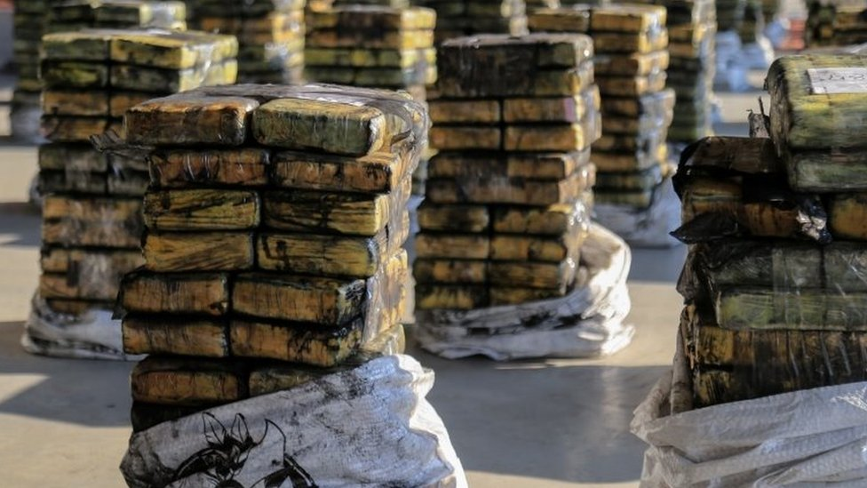 Packages of cocaine that were hidden in a shipment of six charcoal containers that were to be shipped to Israel are seen after being seized by an anti-narcotics unit in the Terport de Villeta port in Villeta near Asuncion, Paraguay, October 20, 2020.