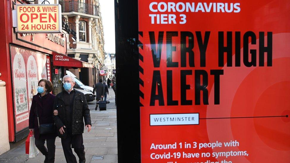 Shoppers in London on 17 December 2020