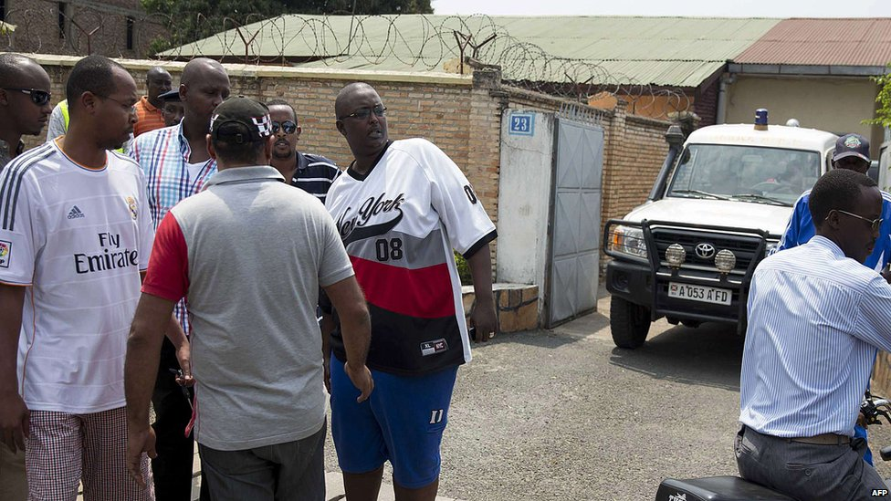 Relatives of Colonel Jean Bikomagu stand outside his home on 15 August 2015