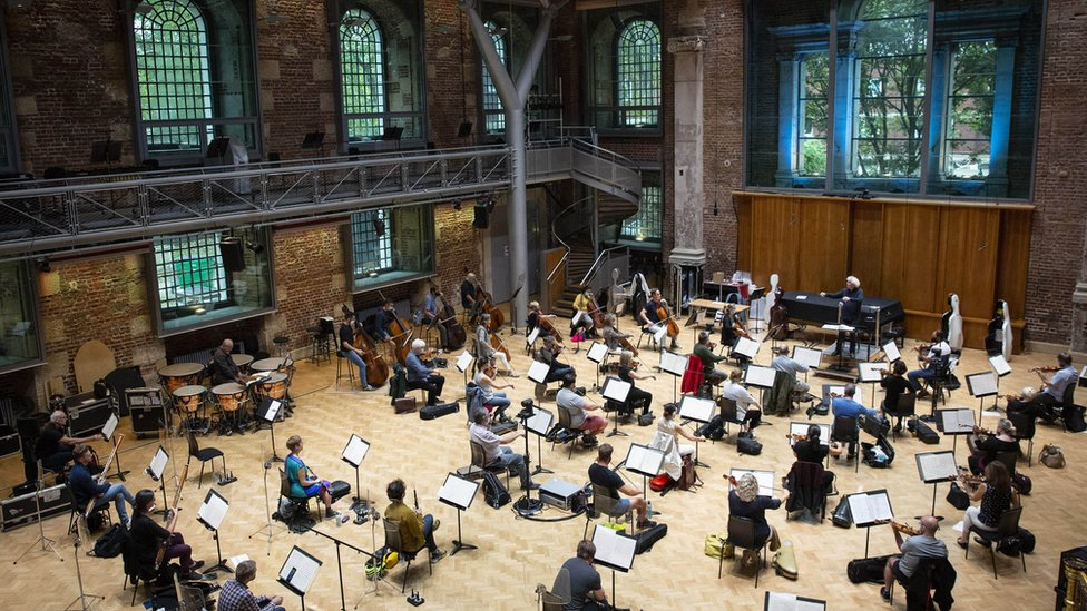 Sir Simon Rattle rehearsing with the London Symphony Orchestra at LSO St Luke's in London in August