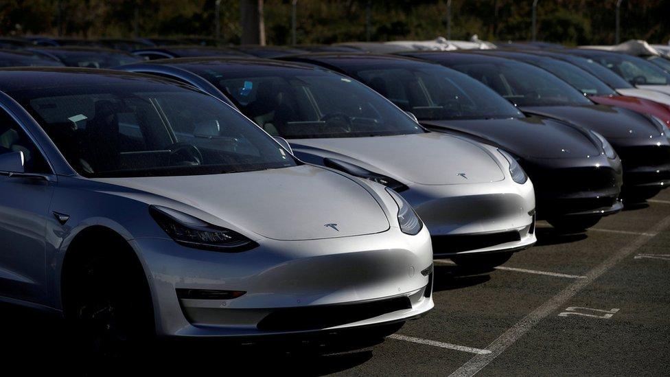 A row of new Tesla Model 3 cars