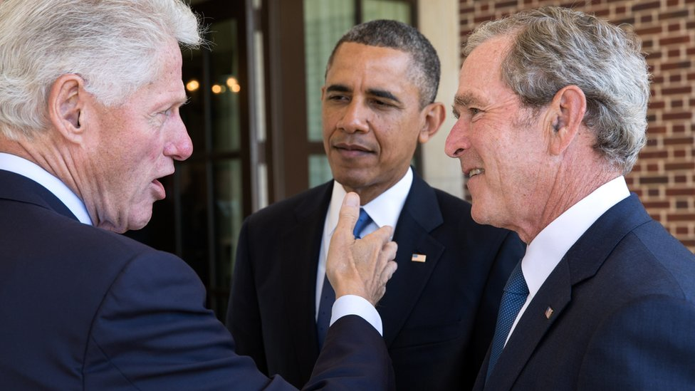 Bill Clinton, Barack Obama and George W Bush in discussion at a event in April 2013