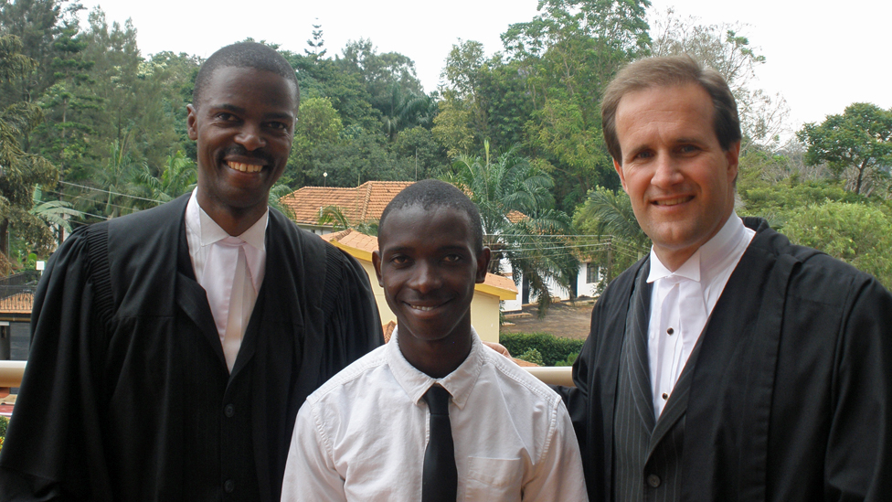 Henry with his Ugandan and American lawyer