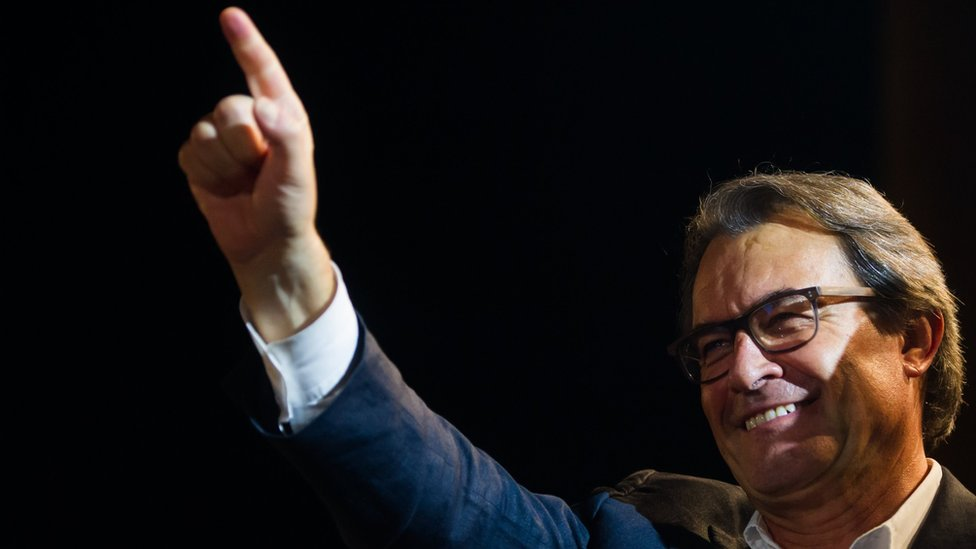 President of Catalonia Artur Mas waves at a rally, 27 September 2015