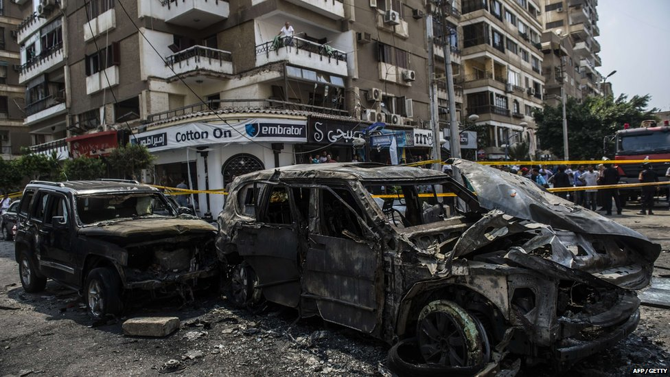 Burnt-out vehicles are seen at the site of a bomb attack that targeted the convoy of the Egyptian state prosecutor, Hisham Barakat, who died hours after the powerful explosion hit his convoy, in the capital Cairo on 29 June 2015.