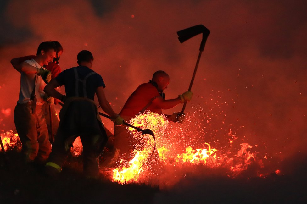 Fire fighters tackle a wild fire on Winter Hill near Bolton. 28 June 2018.