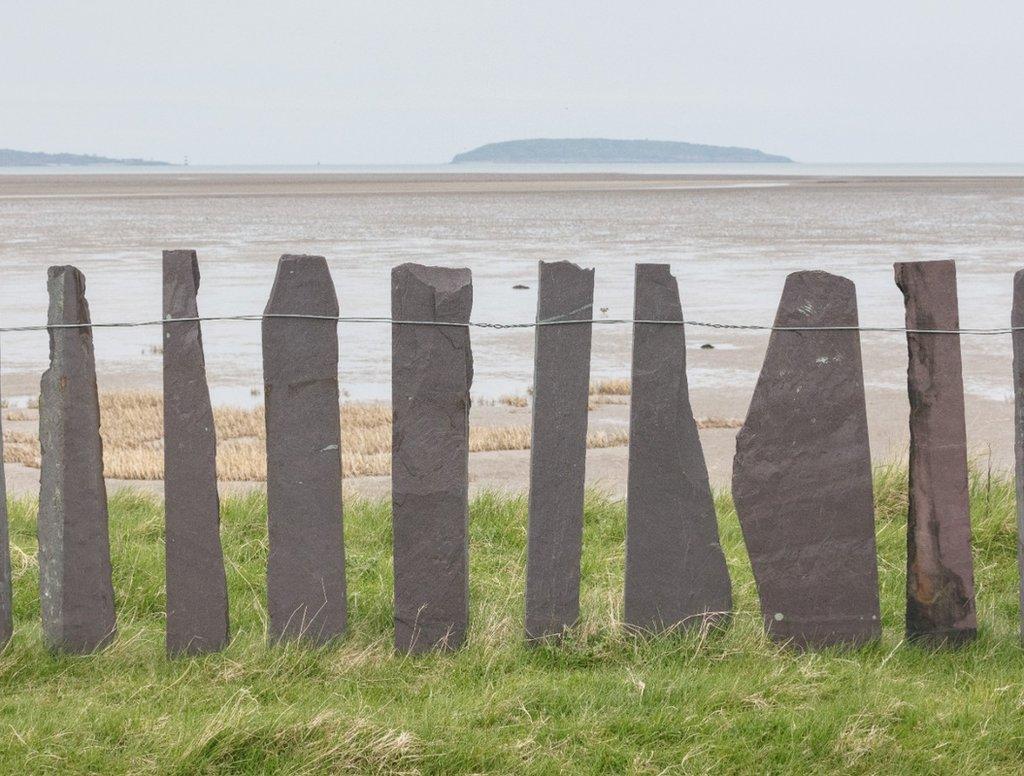 Slate fence and Puffin Island, Lavan Sands, Gwynedd.