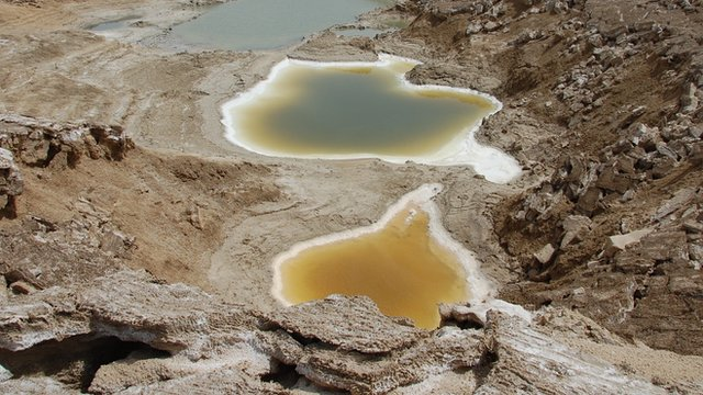 An image taken by a BBC drone above a series of sinkholes that appeared as the Dead Sea retreated
