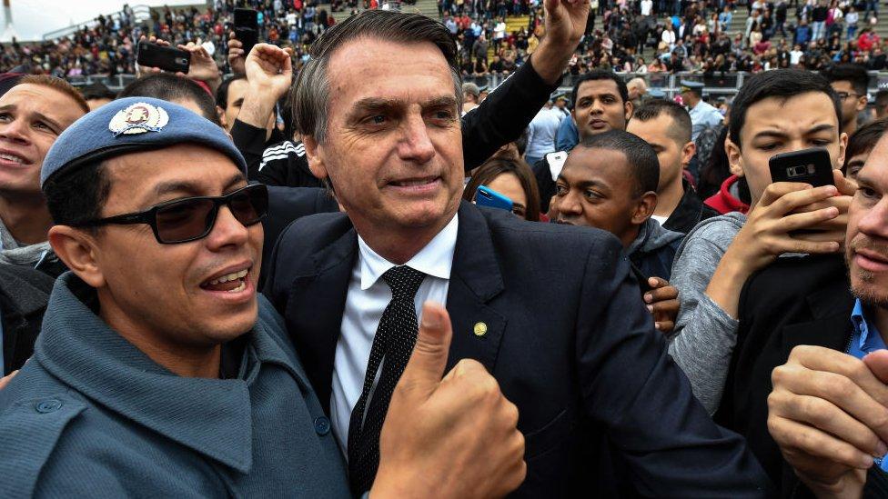 Bolsonaro surrounded by men