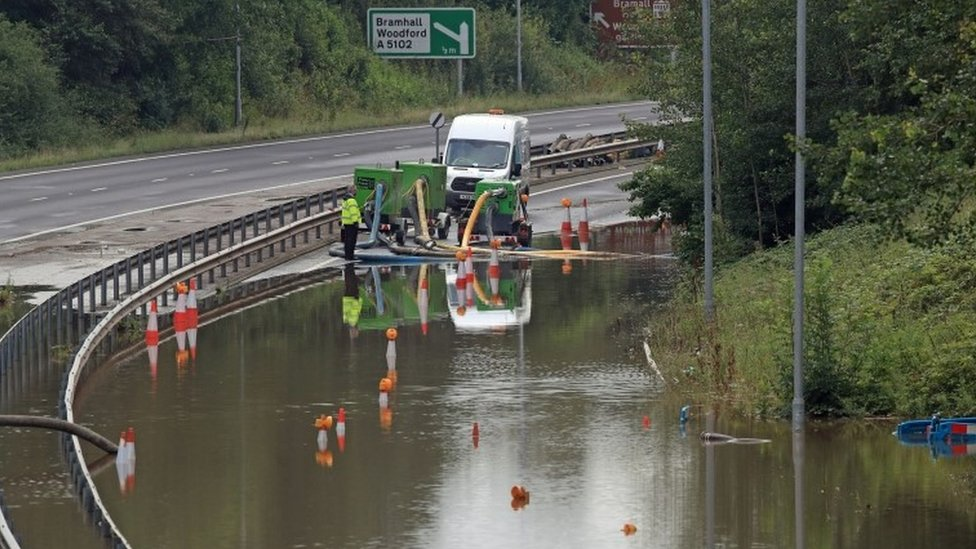 Flooding being pumped on A555 in Stockport