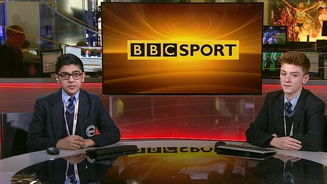 Two school children in a sports news studio