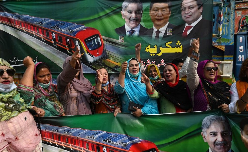 Opposition supporters of Pakistan Muslim League-Nawaz (PML-N) shout slogans after the official opening of the newly built Orange Line Metro