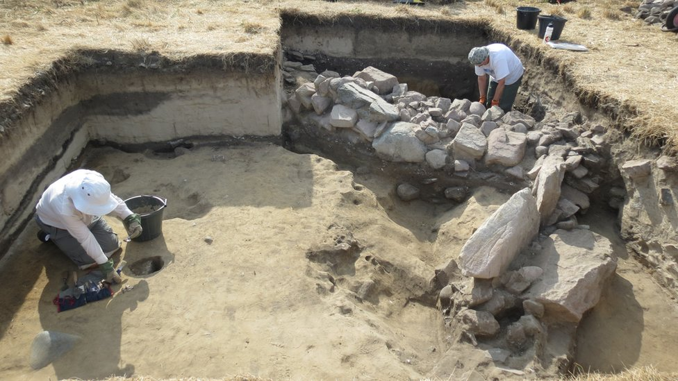Archaeologists at the dig