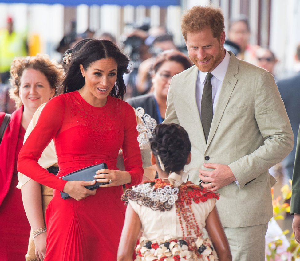 Prince Harry, Duke of Sussex, and Meghan, Duchess of Sussex, arrive at Fua'amotu Airport on 25 October 2018 in Nuku'Alofa, Tonga