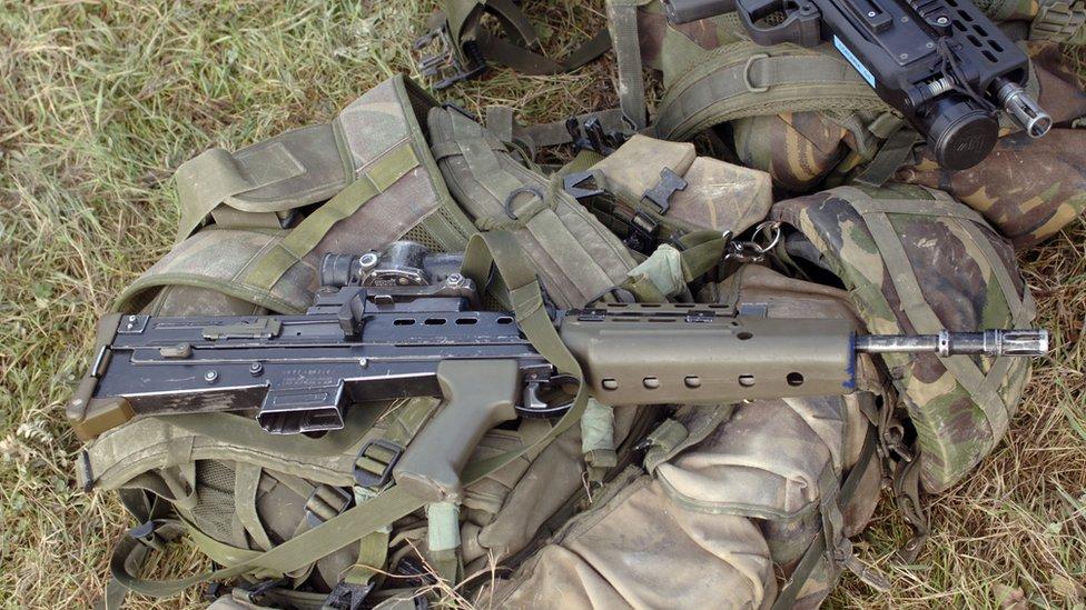 An SA80 assault rifle on top of Army gear