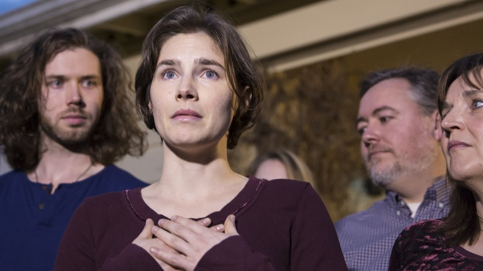 Amanda Knox speaking at a press conference with her family after she was acquitted of murder in 2015