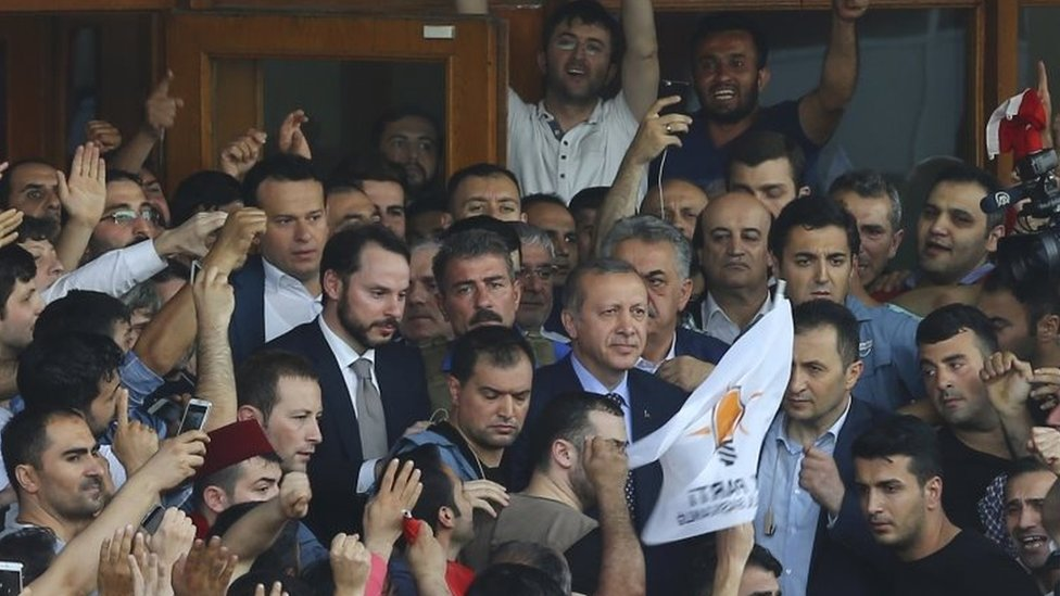 Turkish President Recep Tayyip Erdogan (centre) and his supporters at Istanbul airport. Photo: 16 July 2016