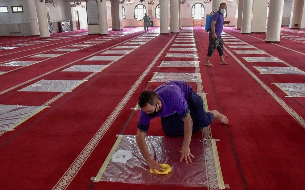 Algerian volunteers desinfect the prayer hall ahead of the noon prayer at the El Fateh mosque in the El Afia de Kouba neighbourhood of the capital Algiers, on August 15, 2020.